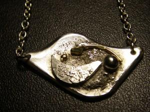 Egentillverkat silverhänge